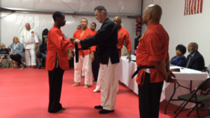 Photo 5 Elite student Evan Franklin receives certified black belt from Nutter at Re-opening